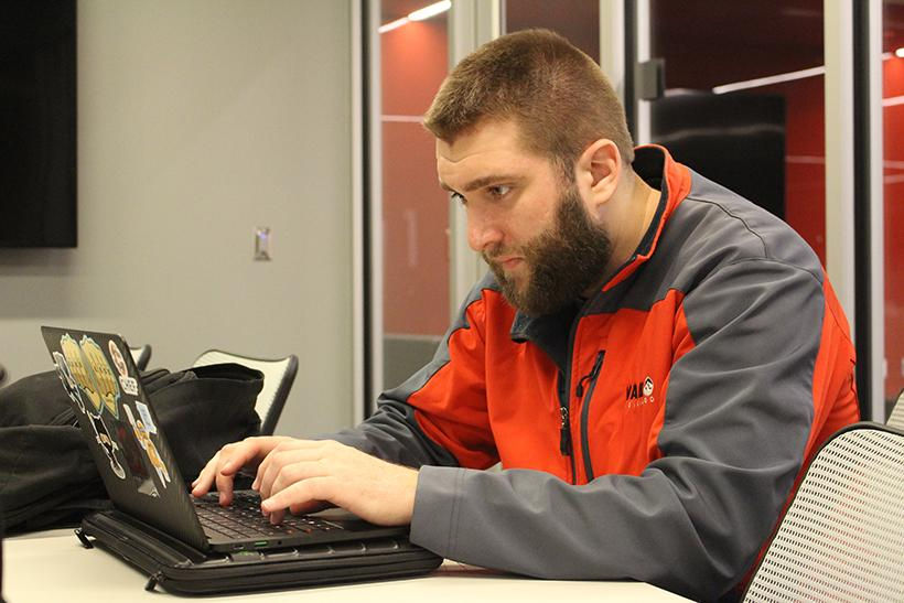 Ryan Charles, a senior in the computer science program at the Missouri Innovation Campus in Lee's Summit, works on a coding assignment. Charles is one of many nontraditional students who commute to classes from Kansas City. (Photo by Garret Fuller/ Senior Writer)