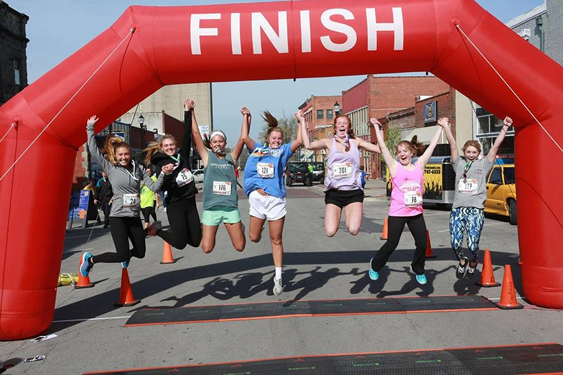 (Photos courtesy of the Blaine Whitworth Foundation) A group of runners from 2017 celebrate finishing the 5K.