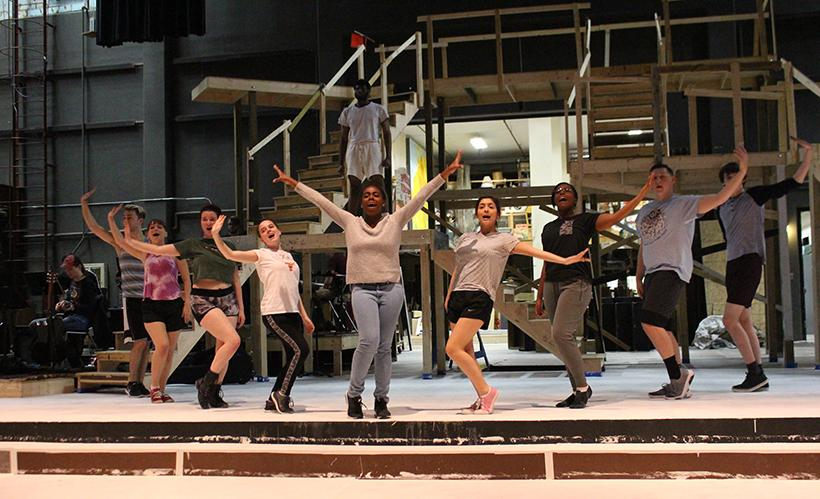 """(Photo by Jason Brown/ Managing Editor) The """"Godspell"""" cast rehearses the musical number """"Bless the Lord"""" Tuesday in the Highlander Theater"""