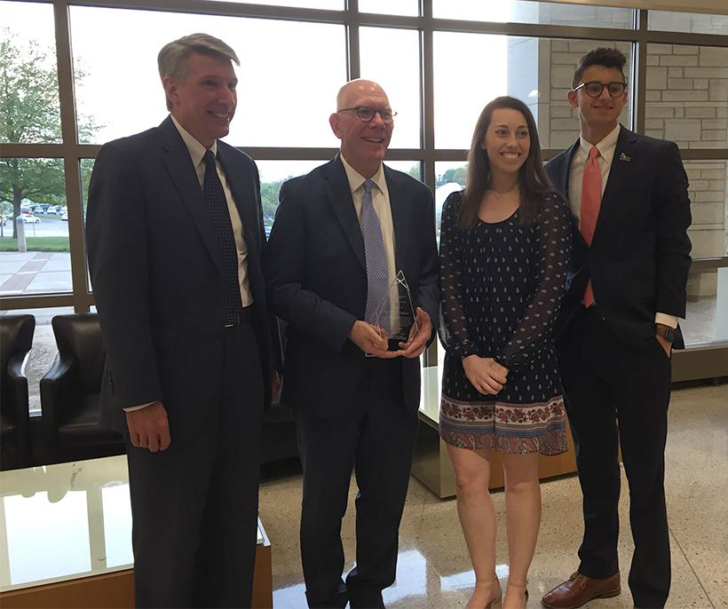 UCM President Roger Best; Kirkpatrick award winner Chuck Ambrose; SGA past President Courtney Abt and SGA newly elected President Cole Fine pose for a photo with Ambrose and his award. (Photo by Erin Wides/Features Editor)
