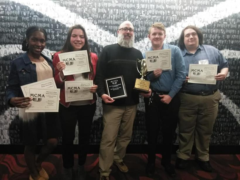 From left, Muleskinner staff Erin Wides, Jason Brown, Matt Bird-Meyer and Anaiyeh Smith pose with the Muleskinner's awards April 13 at the MCMA Conference in Springfield, Missouri. (Photo by Garret Fuller/ Senior Writer)