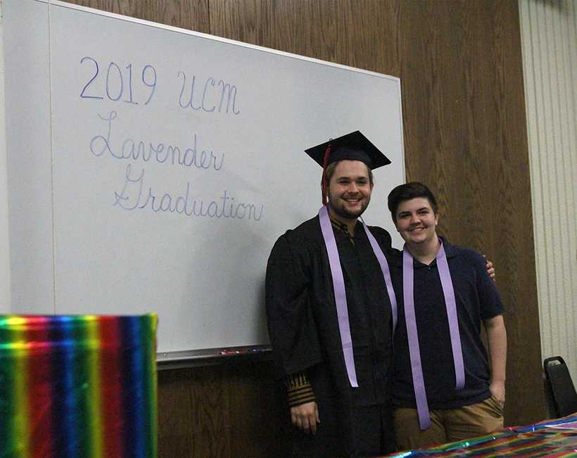 From left, Sean Ryun and Bryce Klein, both seniors, pose for a celebratory photo with their temporary lavender chords after being recognized at Lavender Graduation ceremony on April 18. (Photo by Erin Wides/ Features Editor)
