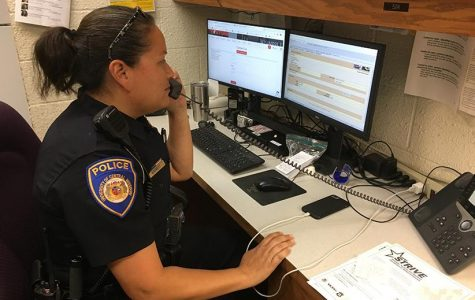 Angela Garrett, a police officer for the University of Central Missouri's Department of Public Safety, files a report. (Photo by Garrett Fuller)