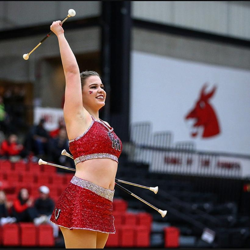 Amanda Glenski, senior History and political science major, twirls at a Mules basketball game. Glenski has been twirling and throwing batons since she was 8 years old. (Photo submitted by Amanda Glenski)