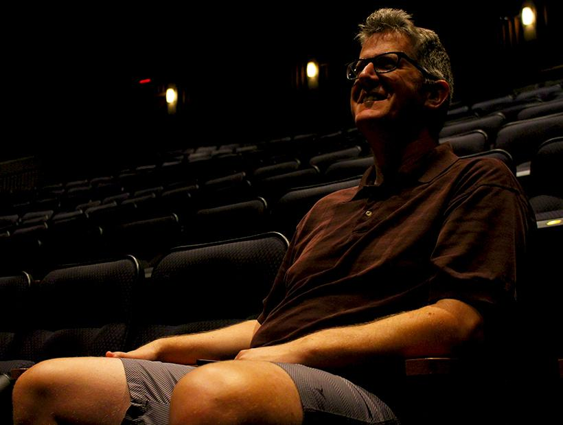 Jacob Sentgeorge, associate professor of music and voice, watches a rehearsal of Hairspray in the James L. Highlander Theatre. Sentgeorge is the play's music director. The play runs in Highlander Theatre Thursday-Sunday. (Photo by Chris Holmberg/Muleskinner)