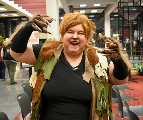 Christina Moore, a senior general studies major, shows off her costume for the Midterm Monster Mash in the Elliott Student Union. (Photo by Katlin Younts)