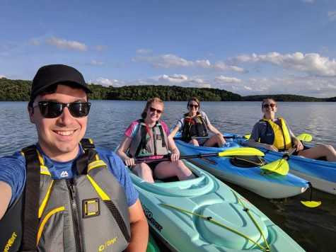 "From left: Max, Natalie, Michelle and Maddy pose for a photo on the lake. ""I enjoy kayaking with my friends because it's a fun way to stay active without having to run,"" Anderson said."