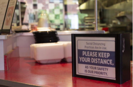 Todd Dining Hall displays signage indicating the COVID-19 social distancing directives. The dining halls only permit patrons to enter during designated times for scheduled cleaning.