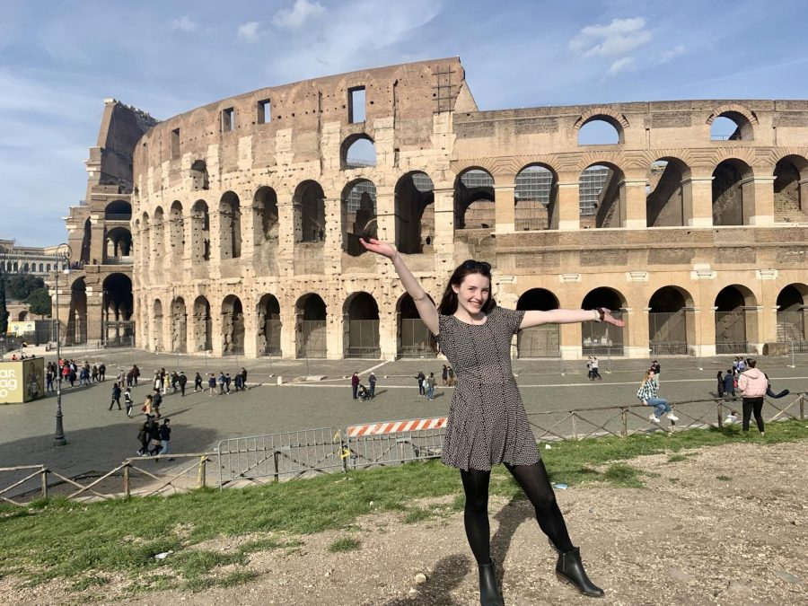 Junior Colleen Wright stands in front of the Colosseum in Rome, Italy. Photo submitted by Colleen Wright