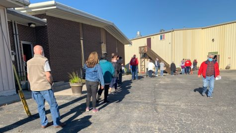 Voters wait in line at New Hope Baptist Church in Independence, Missouri to make their voices heard in the 2020 Presidential election.