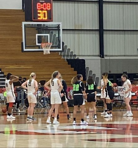 The Jennies start lining up as the Riverhawks set to make a free throw because of the foul against the Jennies.