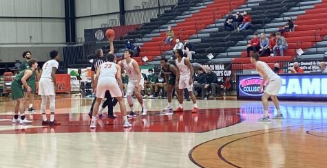 The Mules are in position as the ball is tipped off to start the game against the Riverhawks.