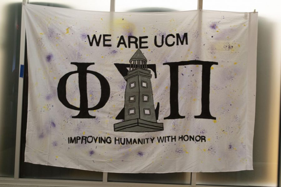 "Phi Sigma Pi's spirit banner was placed in the Student Recreation and Wellness Center during the week of the We Are UCM event. Phi Sigma Pi placed first in the spirit banner competition. ""I didn't expect to win at all. Making the banner was a lot of fun, so it was nice to win,"" Myra Cornwell, member of Phi Sigma Pi, said."