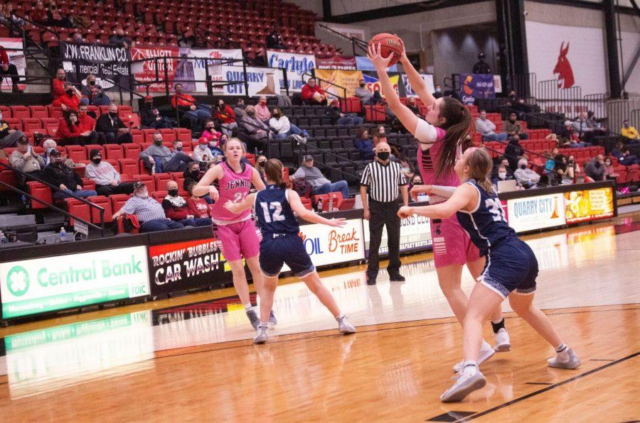 Freshman Graycen Holden catches the ball against her opponent.