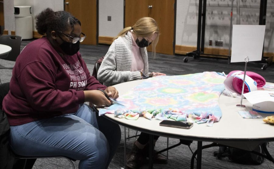 Sondra Bellard, junior psychology major, is a member of Phi Sigma Pi. Her organization participated in community day by making fleece blankets to be donated.