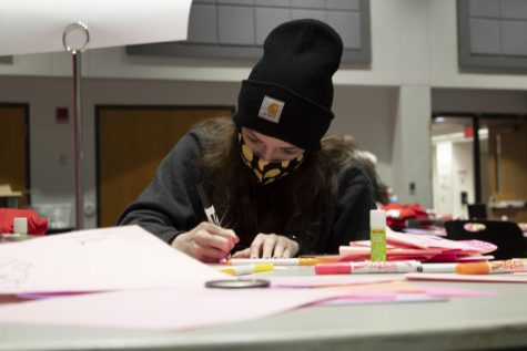 "Erin Frazier, sophomore secondary education major, makes Valentine's Day cards for students in quarantine and for the residents of Ridgecrest Nursing Center. ""Specifically for today it's awesome because one of my sisters was telling us earlier that she was born premature, so she spent a lot of time in the NICU,"" Frazier said. ""So this is all really impactful for her because she's able to give back to the NICU nurses and to the kids who are in Children's Mercy."""