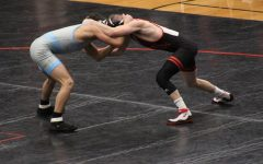 At 125 pound weight class, freshman Trevor Wishne is in position with his opponent, JJ Gillbert. The match lasted the full seven minutes but in the end Gillbert won the match. The Jets started off 5-0 against the Mules.