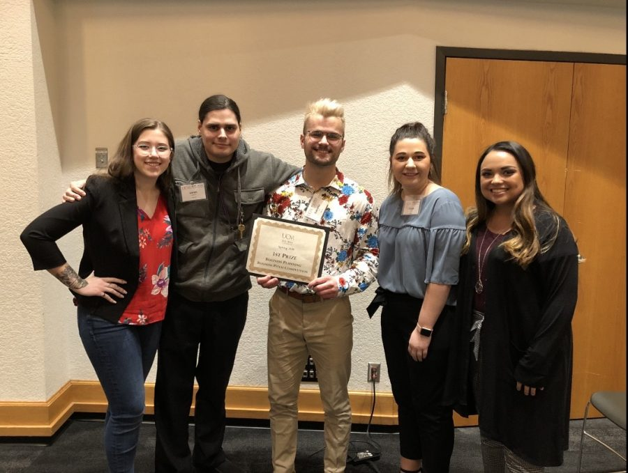 """Dakotta Hunt (center) and his entrepreneurship team at the 2020 spring UCM Big Idea Conference. Hunt, an ESE alum, enjoyed his experience at UCM. """"It felt like a whole lot of work, but the work was really rewarding,"""" Hunt said."""