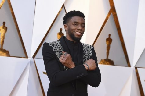 In this March 4, 2018 file photo, Chadwick Boseman arrives at the Oscars at the Dolby Theatre in Los Angeles. Actor Chadwick Boseman, who played Black icons Jackie Robinson and James Brown before finding fame as the regal Black Panther in the Marvel cinematic universe, has died of cancer. His representative says Boseman died Friday, Aug. 28, 2020 in Los Angeles after a four-year battle with colon cancer. He was 43. (Photo by Jordan Strauss/Invision/AP)