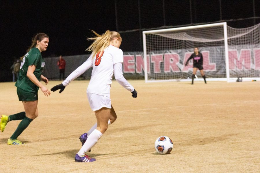 Junior forward Kassie Newsom gets around her opponent to score a goal for the team.