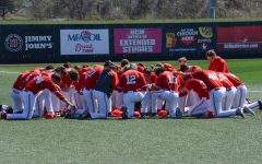 The UCM Mules baseball team takes a moment before the game started against Washburn Ichabods.