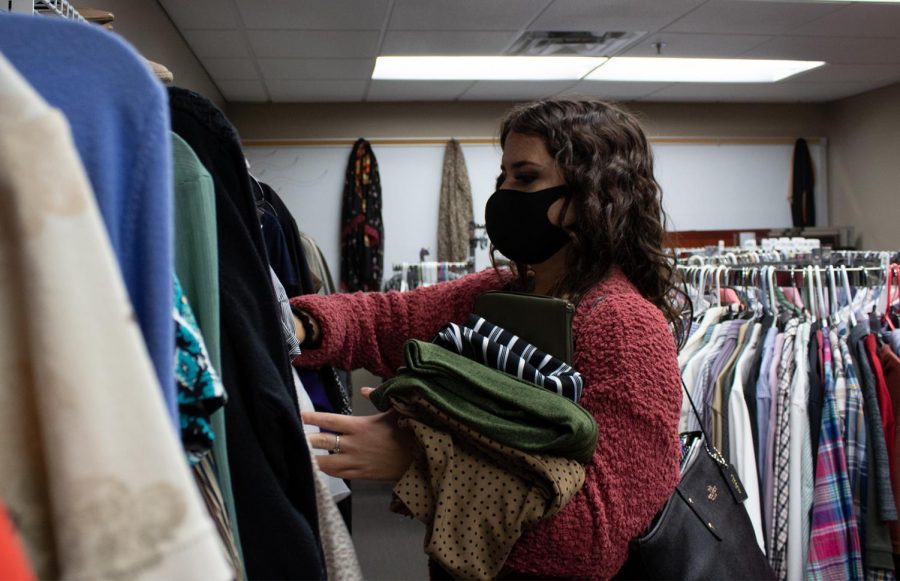 """Senior business management major Autumn Wolf looks through the clothing options at the Professional Clothes Closet. """"Currently, I have a specific dress code, so I wanted to expand my clothing collection by coming and looking at all of the awesome and free stuff that Robin has here at the wardrobe,"""" Wolf said. Currently you can pick up to four pieces of free clothing at the closet each month."""
