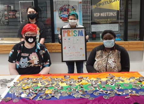Prism members encouraged students to wear pride colors and come by their table in the Elliott Student Union for stickers, candy and pronoun buttons. Photo submitted by Michael Reece