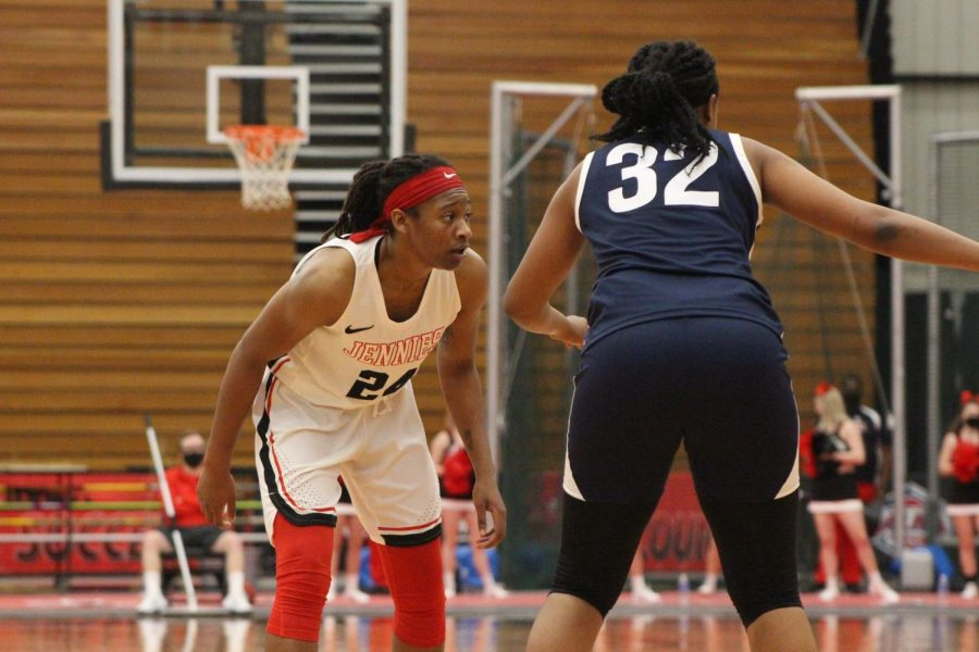 Senior guard Nija Collier glances at her teammates to signal a play. Collier will return for the 2021 season. Photo by Emily Dickmeier