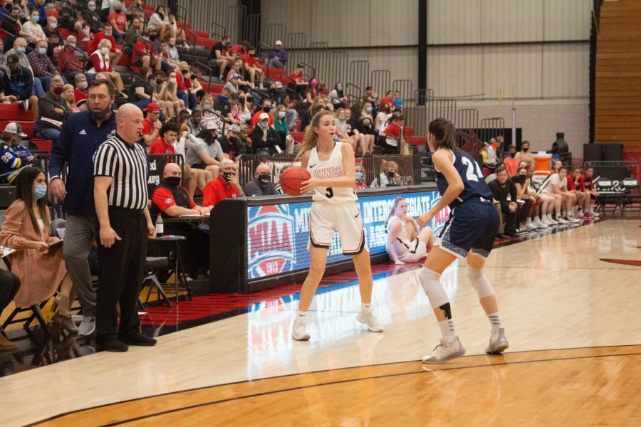 Senior guard Gigi McAtee looks to pass the ball to another teammate. After the season ended, McAtee prepares to graduate in May. Photo by Meah Copeland