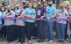 """The Shelter, W.A.R, and multiple  community members stand together to cut the ribbon. """" This turnout has been awesome, I didn't expect this many people and you know it's just getting started,"""