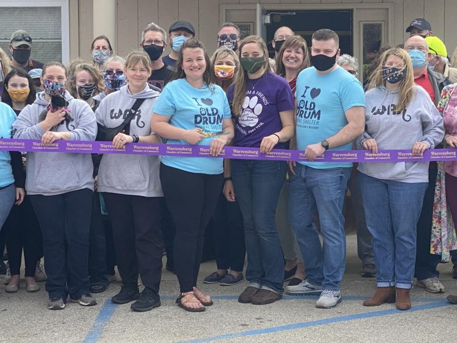 "The Shelter, W.A.R, and multiple  community members stand together to cut the ribbon. "" This turnout has been awesome, I didn't expect this many people and you know it's just getting started,"" W.A.R. President Mason Wirsig said.  Photo By Skye Melcher"