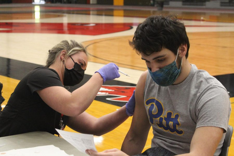 "Sophomore environmental safety major Ean Kenyon receives his first vaccine at the clinic held on April 12. ""I feel really good, both my parents have gotten it already,"" Kenyon said. ""I know a lot of non-students have gotten it, so it's really nice to see that they're finally taking care of the college kids."" The clinic was hosted in the multipurpose building with UCM nursing students administering the vaccine to fellow students."