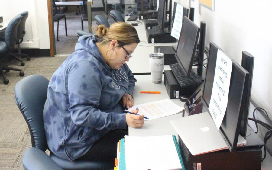 Junior speech language pathology major and TRIO student Tiffani Perez works at one of the TRIO labs in the Humphreys Building.