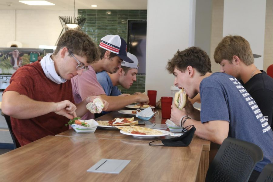 Freshman sports management major Jackson Lunders eats lunch at the newly renovated Todd Dining Hall with friends. I didnt get to see the last one, but it looks really nice, Lunders said.