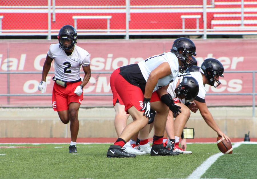 The offensive lineman gets set to do a drill.