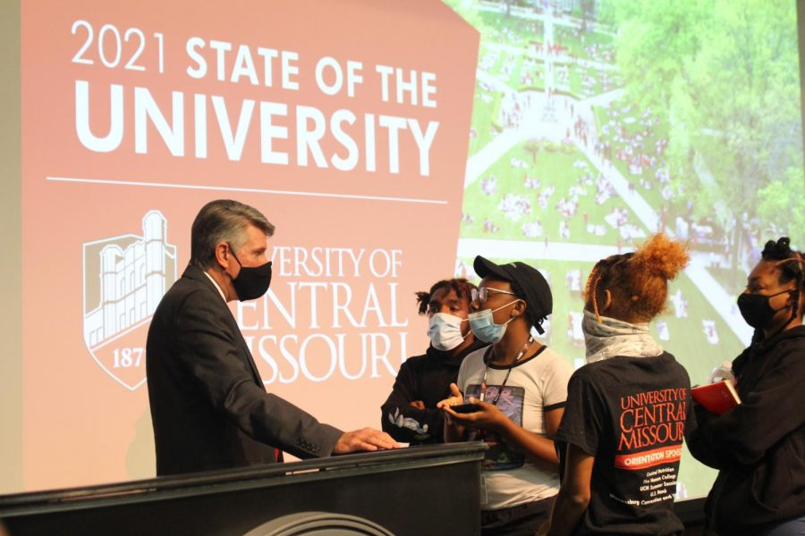 Students speak with UCM President Roger Best following the State of the University Address about a racial slur being written on the free speech wall set up by the American Democracy Project on Sept. 16.
