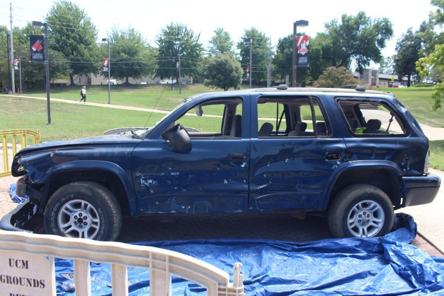Dodge Durango that was destroyed for the charitable car bash put together by the two organizations. Car bash donors were able to hit the vehicle with a hammer. The car was provided by Richeys Auto Salvage in Holden, Missouri. Photo by Matthew Goldsmith