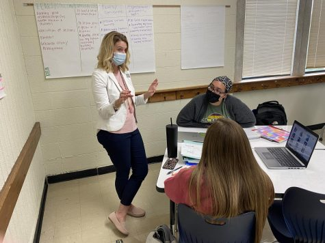 Karrie Snider, associate professor of early childhood education, works with some of her students on a class activity.