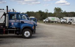 Republic Services trucks sit next to Heartland Wastes old trucks. Republic acquired Heartland on July 21. Republic mechanic Tru Devine said they are working on getting Heartlands trucks road ready to meet their safety standards.