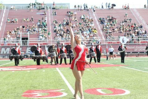Taylor Herrmann twirls her baton at every football game alongside the Marching Mules. Photo courtesy of UCM Bands.