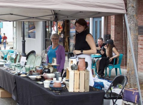 Brittany Walquist and Teresa Scarbrough stand at their booth on Holden street. One of the things today, in chatting with people, is that those who have experience in ceramics are drawn to the booth, and they'll share their experiences, and that's been very satisfying to meet other ceramists, Scarbrough said. She and Walquist have sold separately at various events, but this is their first time running a table together.