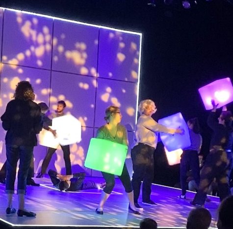 Christopher Boone, played by Luke Habjan, lays on the ground, admiring the stars, while the voices in his head dance around him with colorful blocks, creating the illusion on space. The voices were played by Gracie Health, Luke Englert, Sasha Fuller, Joseph Wandell, Isabella Bryn-Johnson and Anna Braman.