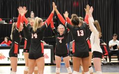 The Jennies do their pre-huddle before each game and set.